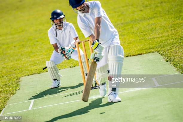 cricket batter hitting the ball - cricket stock pictures, royalty-free photos & images