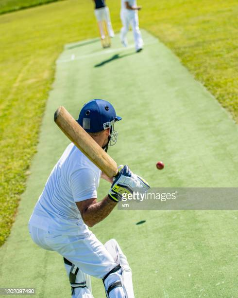 cricket batter preparing to hit the ball - batsman stock pictures, royalty-free photos & images