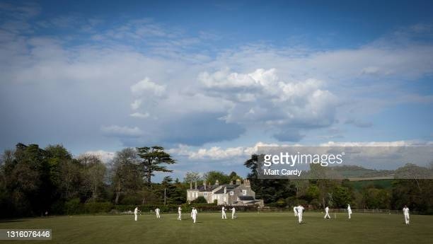 Cricket being played on the Priston Cricket Club field in the village of Priston, on May 2, 2021 in Somerset, England. The easing of COVID-19...