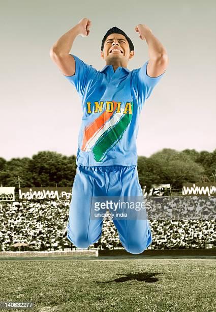 Cricket bowler celebrating his success in a stadium