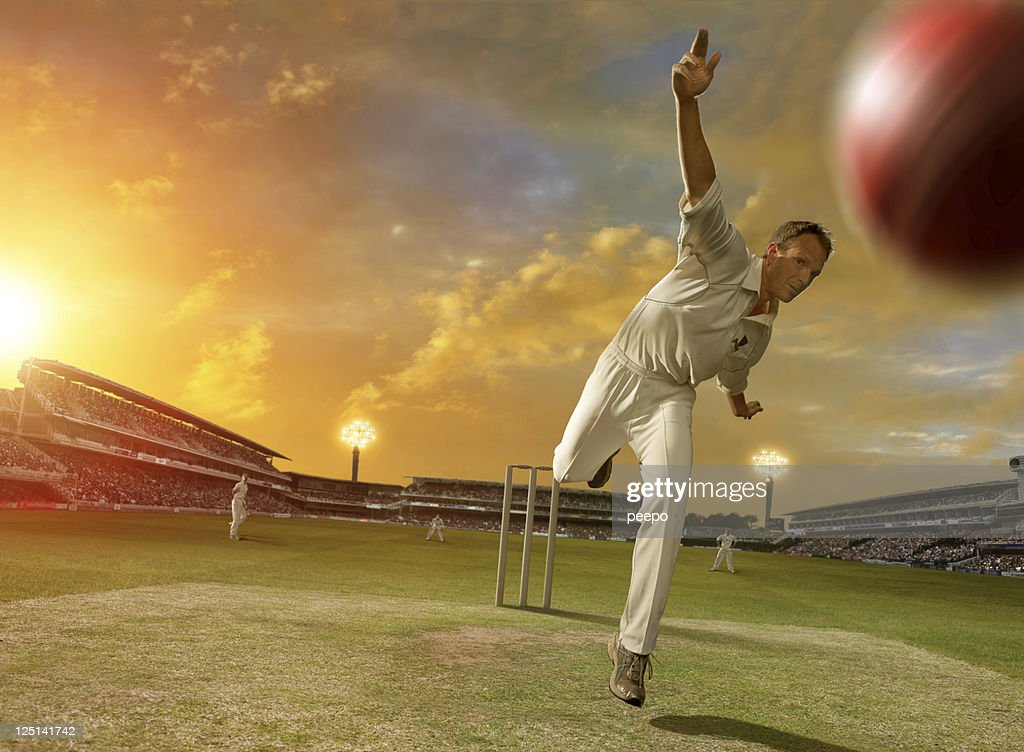 Cricket Bowler in Action : Stock Photo