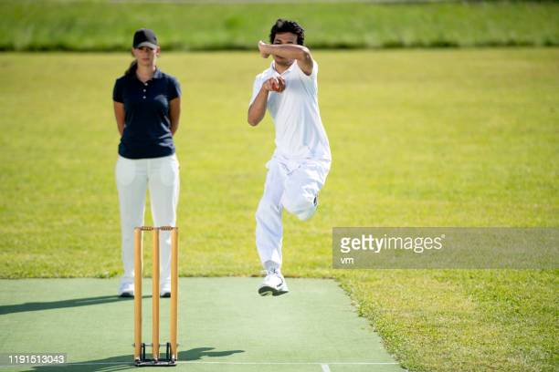 cricket bowler preparing to throw the ball - wicket stock pictures, royalty-free photos & images