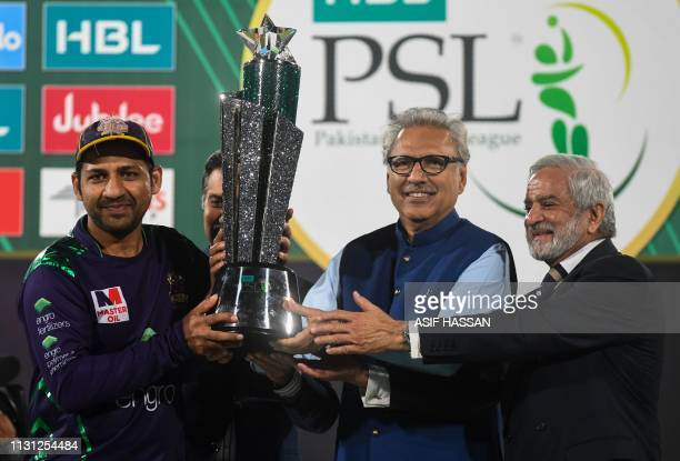 Cricket captain Sarfraz Ahmed of Quetta Gladiators receives the wining trophy from Pakistan President Arif Alvi and Chairman of the Pakistan Cricket...