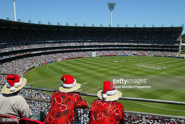 Cricket England tour of Australia Australia v England Melbourne 1st day 3 MEN DRESSED IN CHRISTMAS HATS MAKE UP PART OF THE 65,000 CROWD