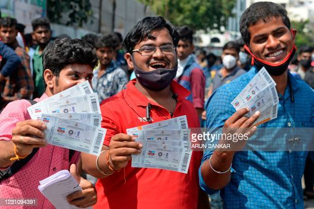 Cricket enthusiasts display tickets for second test match between India and England at the M.A. Chidambaram Cricket Stadium in Chennai on February...