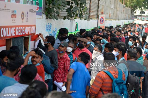 Cricket enthusiasts queue to buy tickets for second test match between India and England at the M.A. Chidambaram Cricket Stadium in Chennai on...