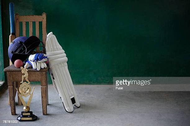cricket equipment and trophy on chair - cricket bat stock pictures, royalty-free photos & images