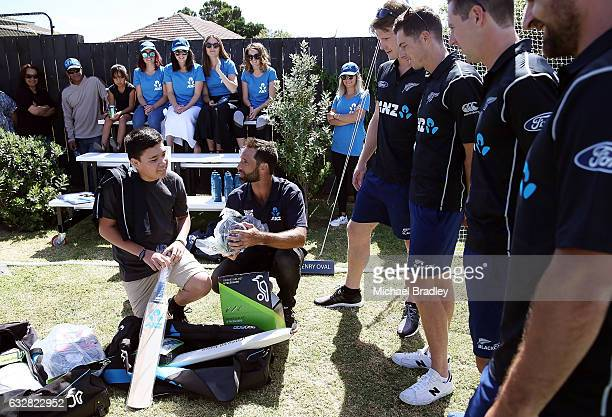 Cricket fan Christopher BrabantHenry aged 14 tries out his gear after he and his sister Regan aged 7 from Mangere couldn't believe their luck after...