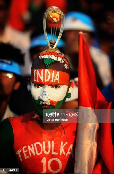 A cricket fan painted in the colours of the Indian flag and player Sachin Tendulkar's name on his chest during the 2011 ICC World Cup second...