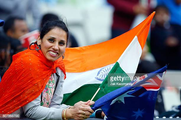 A cricket fan waves flags during the International Twenty20 match between Australia and India at Melbourne Cricket Ground on January 29 2016 in...