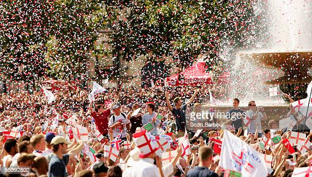 Cricket fans celebrate as the England Cricket team enter Trafalgar Square as part of the Ashes victory celebration on September 13, 2005 in London,...