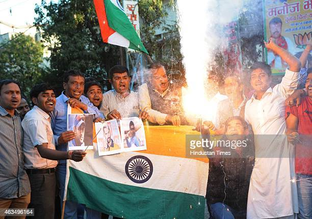 Cricket fans celebrate India's victory over Pakistan in an ICC World Cup 2015 match on February 15, 2015 in Bhopal, India. Cricket fans distributed...