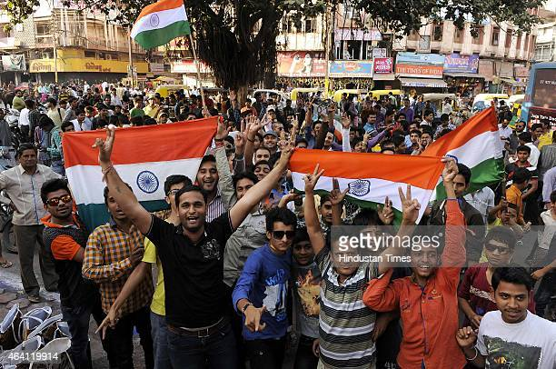 Cricket fans celebrate India's victory over South Africa in an ICC World Cup 2015 match on February 22 2015 in Indore India Cricket fans distributed...