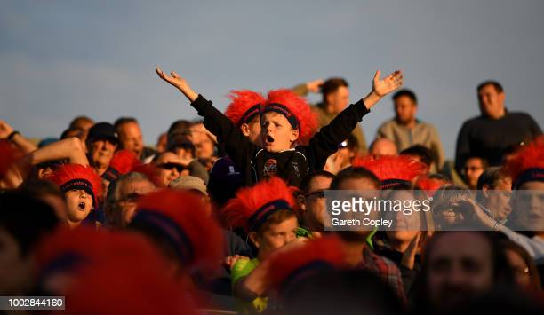Cricket fans cheer during the Vitality Blast match between Lancashire Lighting and Yorkshire Vikings at Old Trafford on July 20, 2018 in Manchester,...