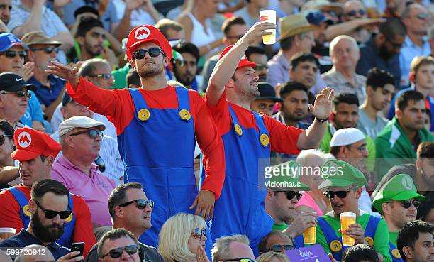 Cricket fans dressed as Super Mario signal an England boundary during the 3rd Royal London ODI between England and Pakistan at Trent Bridge on August...