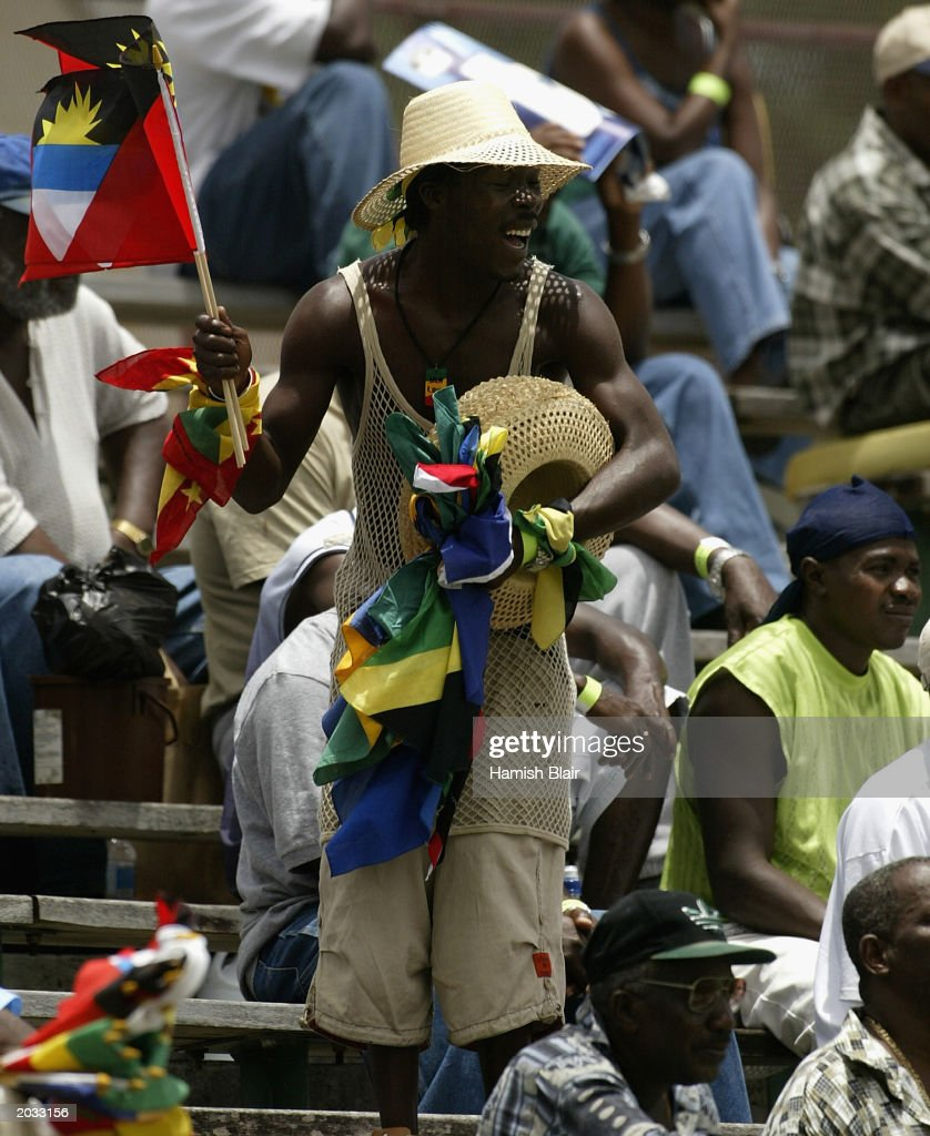 Cricket fans follow the action during day one of the fourth test between the West Indies and Australia played on May 9, 2003 at the Recreation Oval in St John's, Antigua.