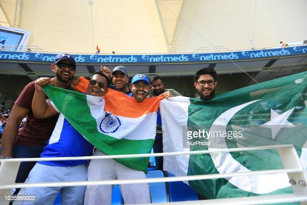 Cricket fans pose for a photograph before the 5th cricket match of Asia Cup 2018 between India and Pakistan at Dubai International cricket...