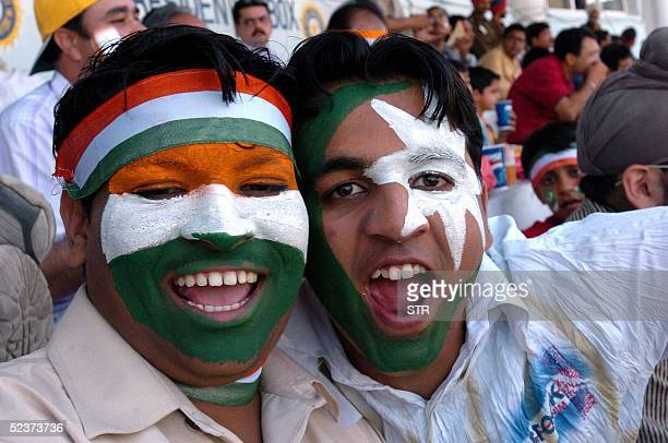 Cricket fans sport faces painted with the Indian and Pakistani flags at PCA stadium in Mohali 11 March 2005 during the fourth day of the first...