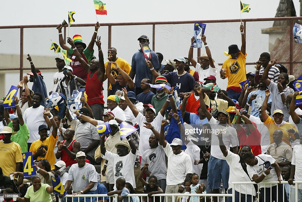 Cricket fans take in the match during day two of the Fourth Test between the West Indies and Australia on May 10, 2003 at the Recreation Oval in St John's, Antigua.
