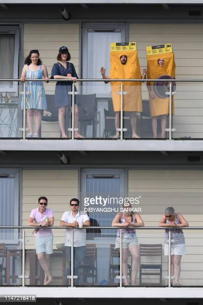 Cricket fans watch from an adjacent building during the 2019 Cricket World Cup group stage match between Afghanistan and Australia at Bristol County...