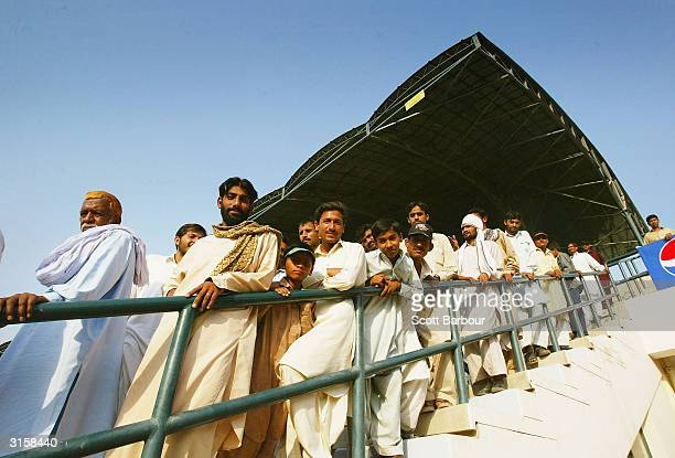 Cricket fans watch the match from the stands during day 3 of the 1st Test Match between Pakistan and India at Multan Stadium on March 30 2004 in...