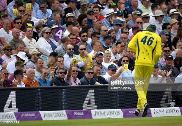 Cricket fans wave sandpaper four cards at Ashton Agar of Australia during the 1st Royal London ODI match between England and Australia at The Kia...