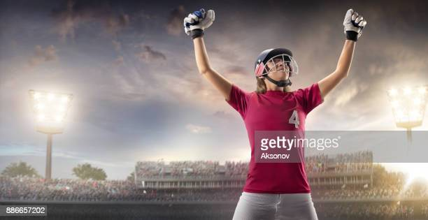 Cricket female batsman happy after the victory on a professional arena