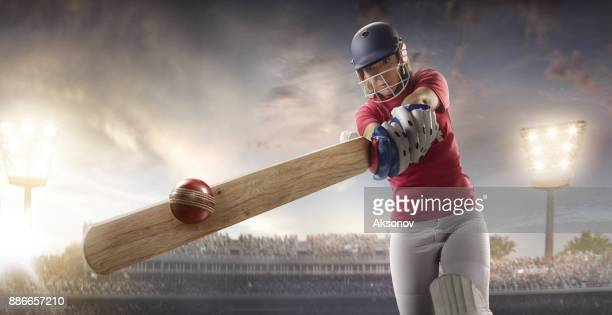 cricket female batsman on a professional arena - cricket player stock pictures, royalty-free photos & images