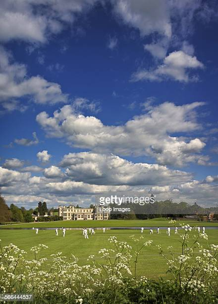 A cricket game being played in the grounds of Audley End