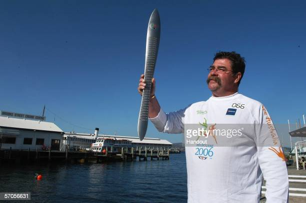 Cricket great David Boon carries the Melbourne 2006 Queen's Baton as part of the Melbourne 2006 Commonwealth Games Queen's Baton Relay March 11 2006...
