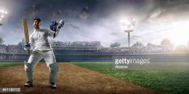 cricket: happy batsman on the stadium - cricket bat stock pictures, royalty-free photos & images
