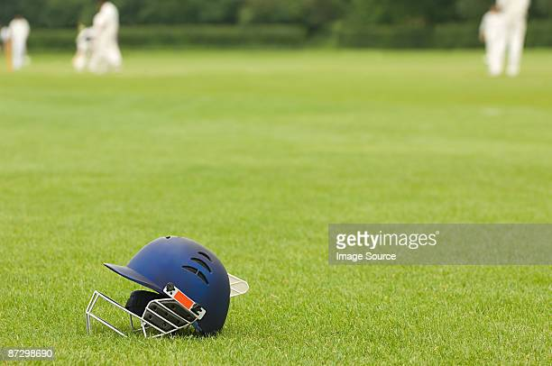 cricket helmet on a cricket ground - cricket player stock pictures, royalty-free photos & images