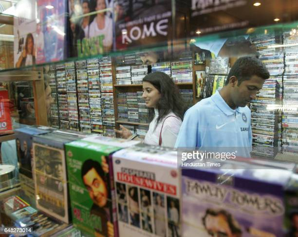 Cricket India vs Bangladesh Indian openers Wasim Jaffer and Dinesh Karthick with Jaffer's wife Ayesha shopping at a DVD shop at Hotel Dhaka Sheraton...