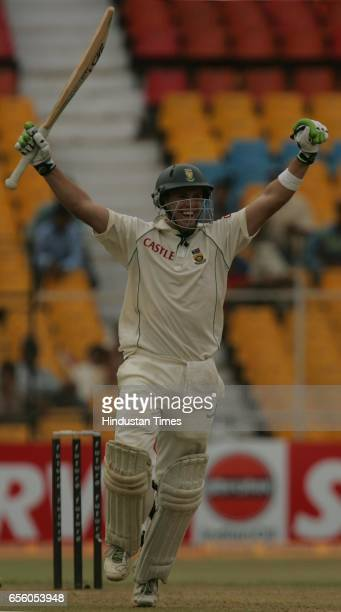 Cricket - India vs South Africa Second Test Match at Ahmedabad - South African batsman A.B. De Villiers celebrates after his unbeaten double century...