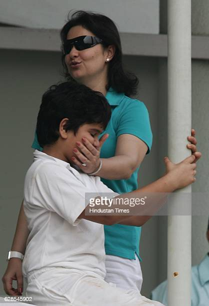 Cricket India vs Sri Lanka Test Series India player Sachin Tendulkar 's wife Anjali and son Arjun watch the match during the fourth day of the third...