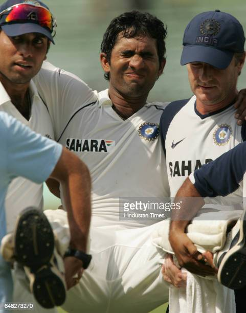 Cricket Indian opener Dinesh Karthick Karthik Carthick is being carried away by VVS Laxman and the physio John Gloster after he suffered from the...