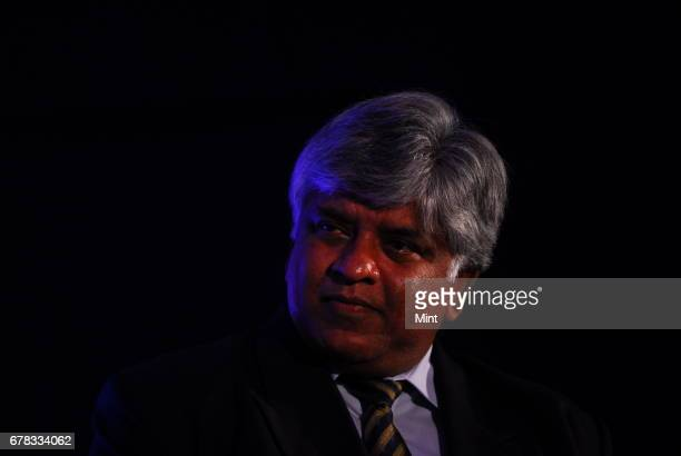 Cricket legend Sri Lanka's Arjuna Ranatunga poses with the ICC Cricket World Cup 2011 trophy during the unveiling of new initiatives and grand plans...
