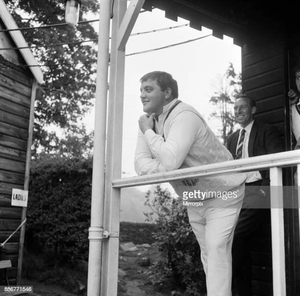Cricket match, Cheshire v Northants. Northamptonshire cricketer Colin Milburn surveys the rain from the pavilion at Macclesfield, waiting for it to...