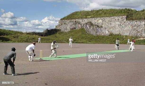 A cricket match in Finland is played on a gravel surface with a nylon mat at a Suomenlinna a sea fortress a ten minute ferry ride from downtown...