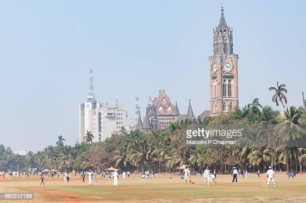 Cricket on Oval Maidan, Mumbai - Mumbai High Court and the Rajabai Clock Tower