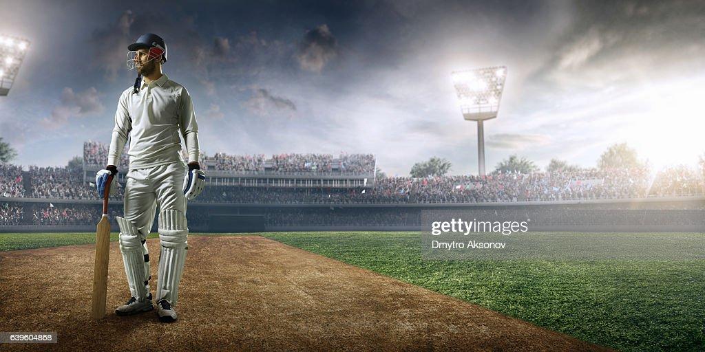 Cricket player batsman on the stadium : Stock Photo
