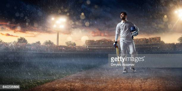 Cricket player batsman on the stadium