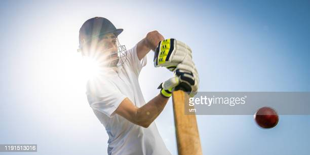 cricket player batting the ball - cricket bat stock pictures, royalty-free photos & images