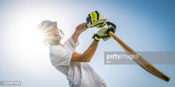 cricket player batting the ball - batting stock pictures, royalty-free photos & images