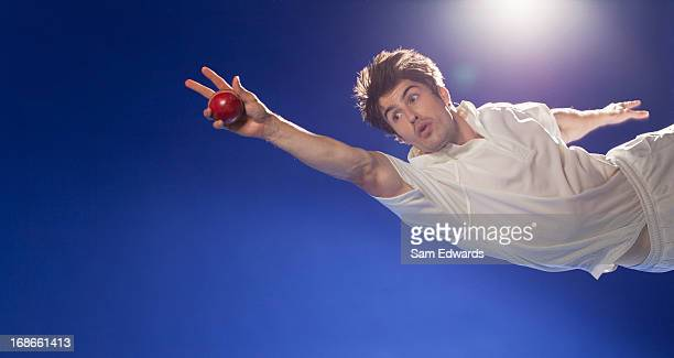 Cricket player catching ball