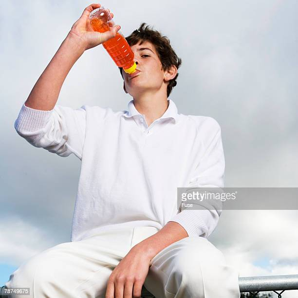cricket player drinking energy drink - energy drink stock pictures, royalty-free photos & images