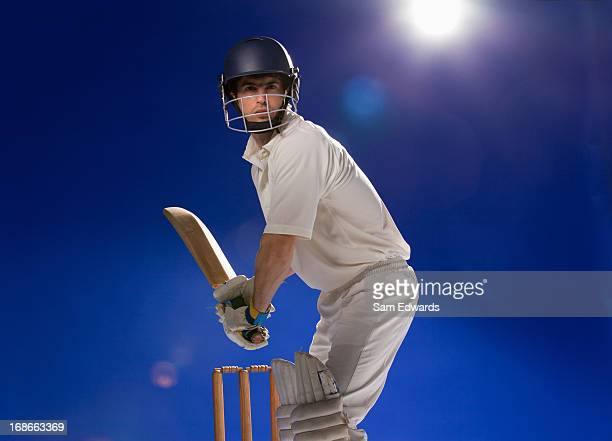 cricket player holding bat - batting stock pictures, royalty-free photos & images