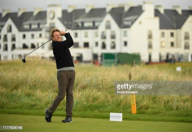 Cricket player Mark Nicholas tees off on the 2nd hole during Day three of the Alfred Dunhill Links Championship at Carnoustie Golf Links on September...