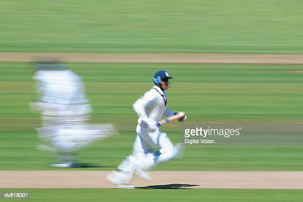 cricket player running - batting stock pictures, royalty-free photos & images