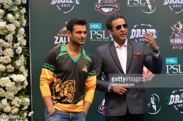 Cricket player Shoaib Malik speaks as former Pakistani cricket captain Wasim Akram present the third edition of the Pakistan Super League draft in...